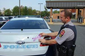 Officers across the agency are placing purple ribbons on their cruisers this month.