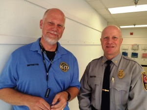 Tom von Hemert, CIT expert, discusses mental health training issues with Colonel Roessler during a class break.