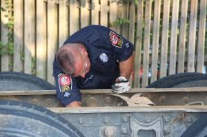 Dan inspecting brake lines