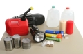 A group of supplies necessary to survive the aftermath of a hurricane or natural disaster - Path included.  (re-edited to avoid blowing highlights on bottles, and clipping path included)