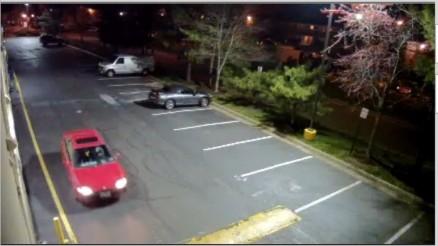 Older red vehicle (Surveillance Photo)